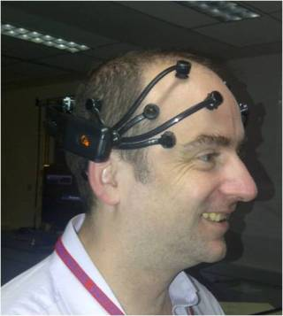 (Photo of me wearing the Emotiv headset, which measures the magnetic waves created by brain activity.)